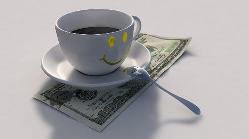 Dolar leży pod filiżanką z kawą